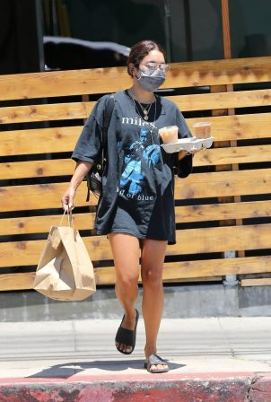 Vanessa Hudgens - Grabbing some food and coffee from a local restaurant in Los Angeles