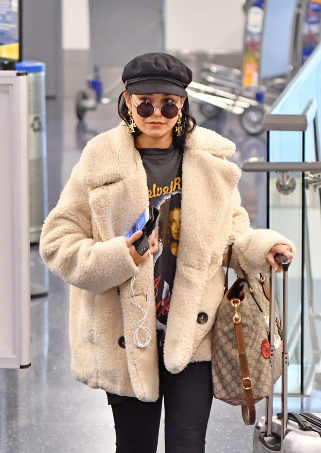 Vanessa Hudgens in Fur Coat - Arrives at LAX Airport in LA