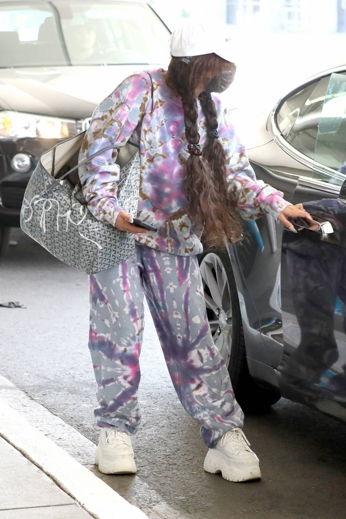 Vanessa Hudgens - In platform sneakers and sweats at LAX in Los Angeles