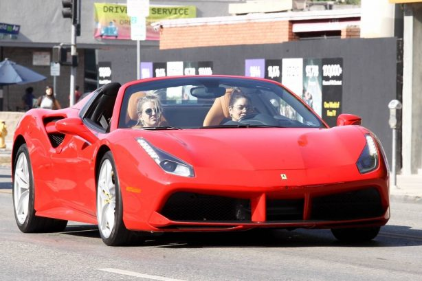 Vanessa Hudgens - Leaving Dogpound gym in her red Ferrari