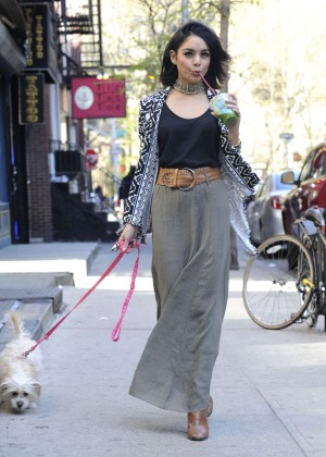 Vanessa Hudgens with her dog out in Soho