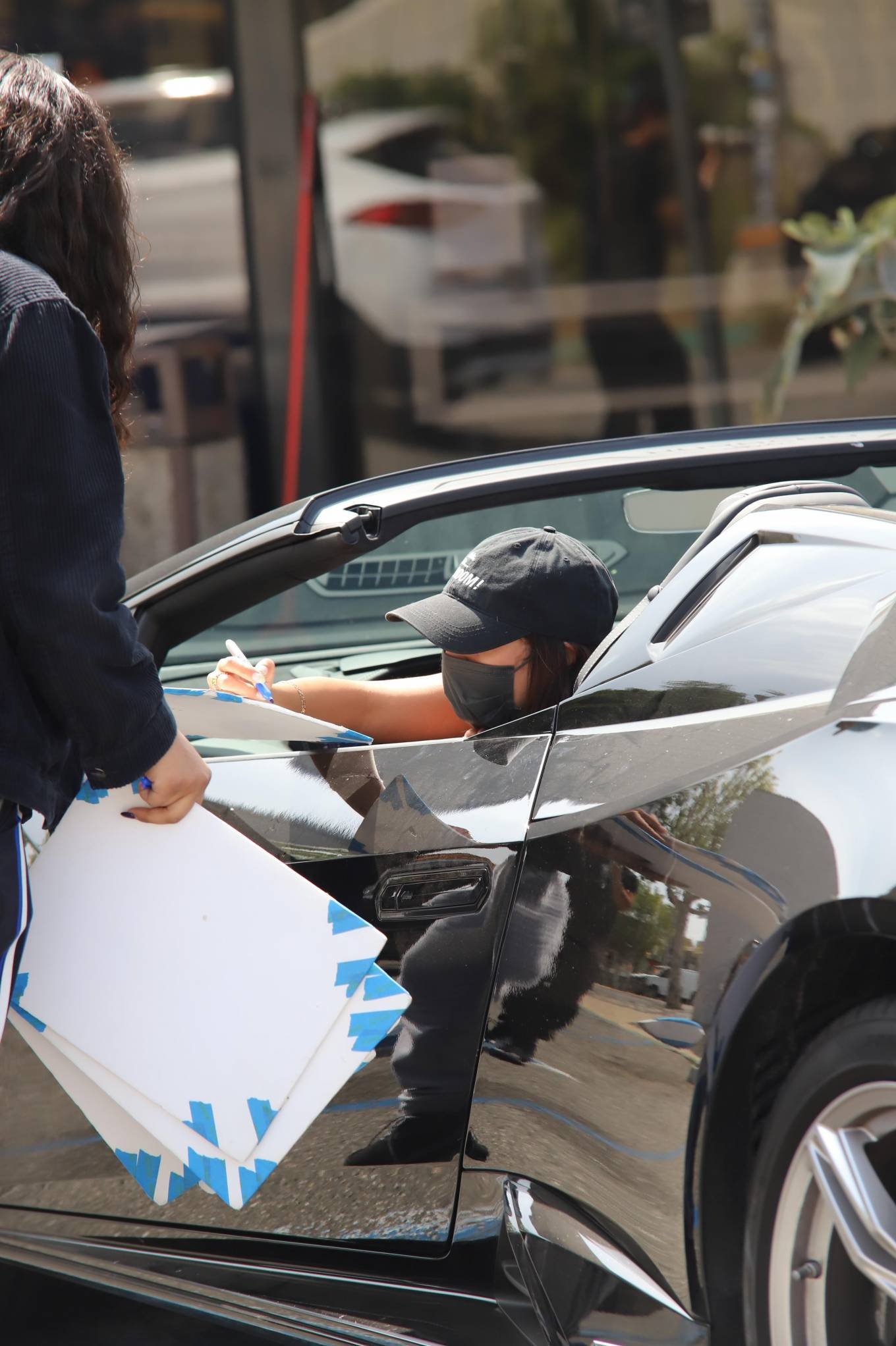 Vanessa Hudgens 2021 : Vanessa Hudgens – Seen in her Ferrari after leaving a workout at Dog Pound in West Hollywood-02