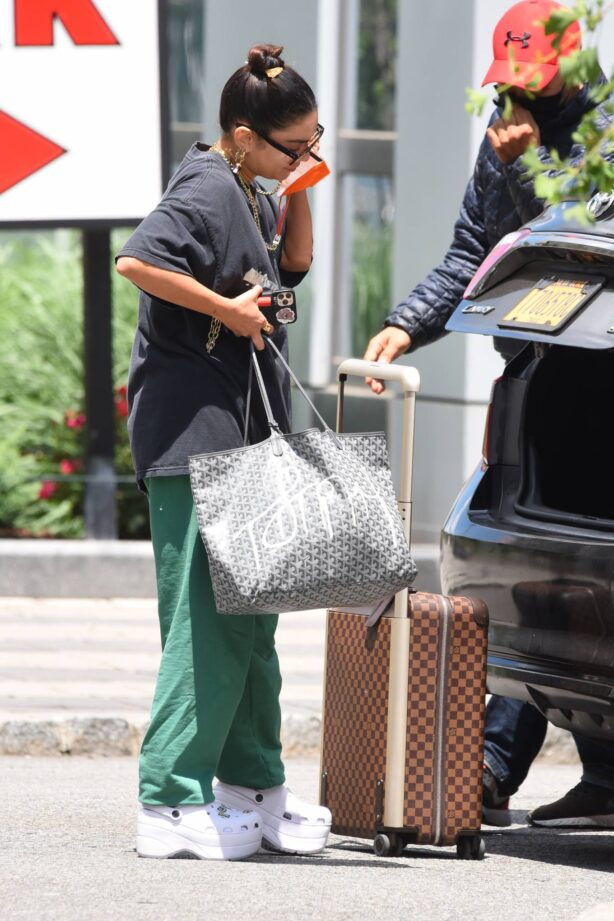 Vanessa Hudgens - Seen with Louis Vuitton luggage in New York City