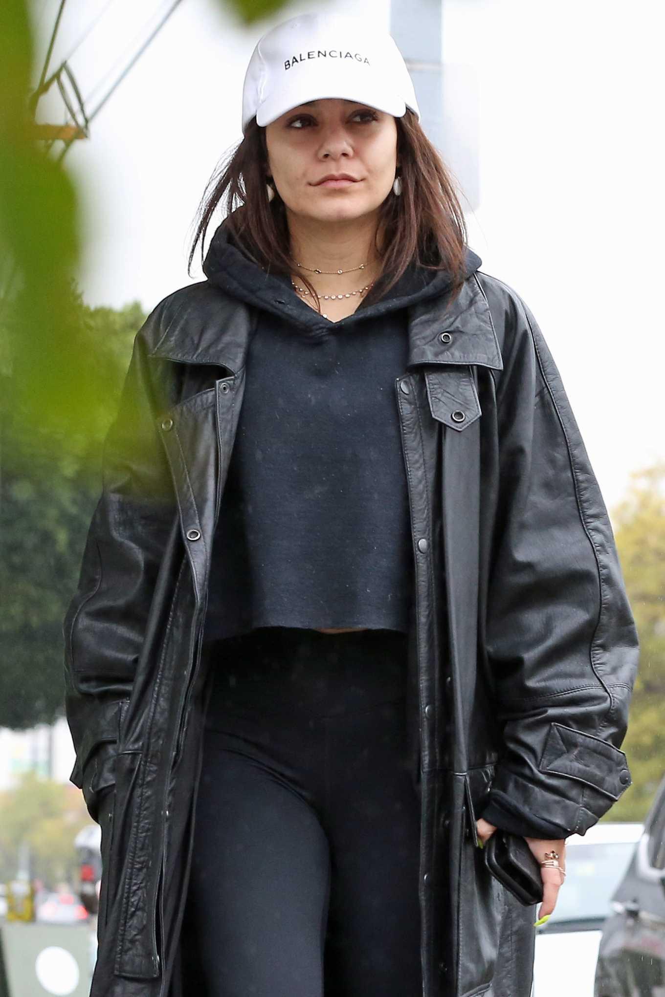 Vanessa Hudgens - Wears a massive coat as she braves the rain in Los Angeles
