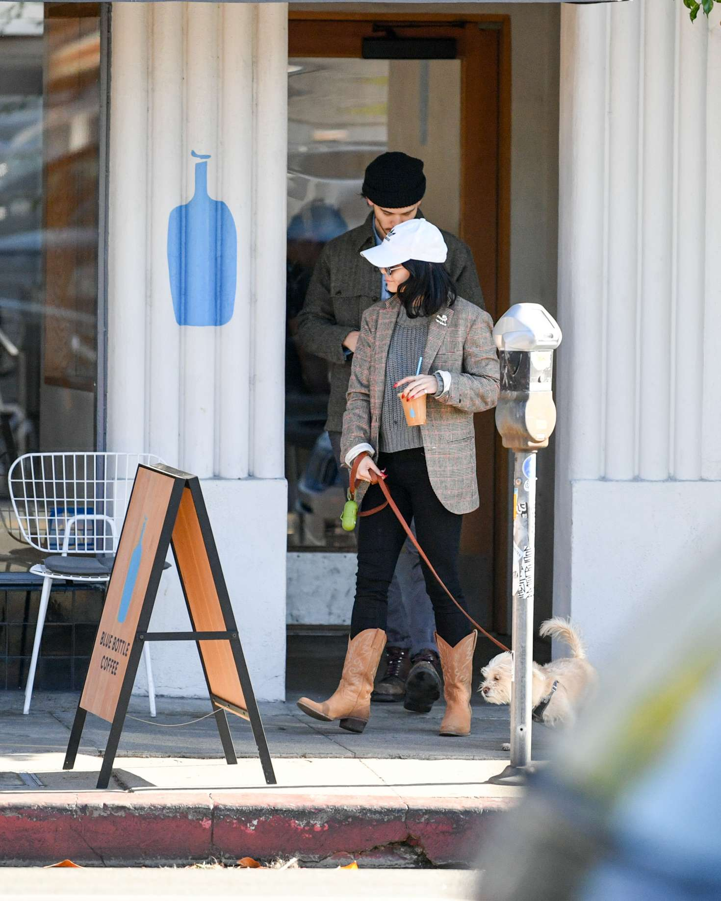 Vanessa Hudgens with her dog out in Los Angeles