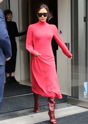 Victoria Beckham in red as she leaves her hotel in New York