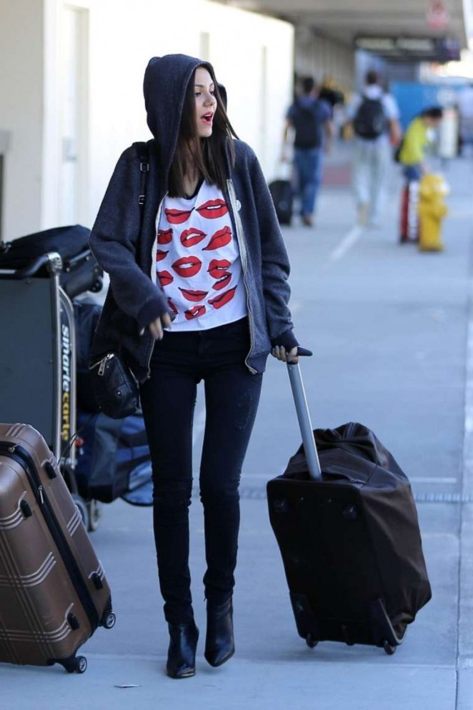 Victoria Justice - Arriving on a flight at LAX airport in Los Angeles