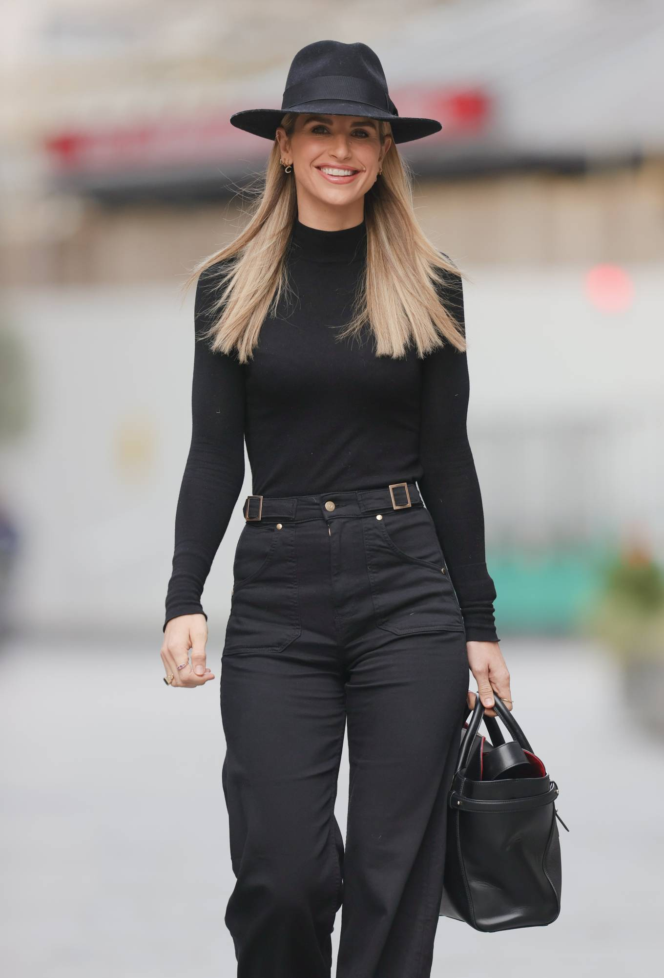 Vogue Williams - In black flares at Heart radio in London