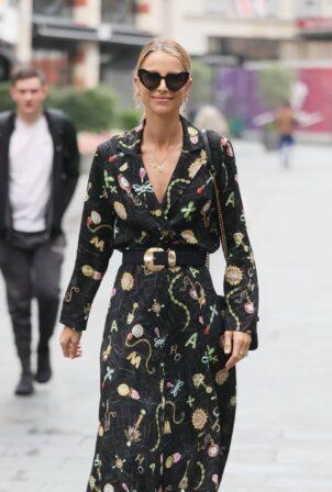 Vogue Williams - In high split flowing dress in London