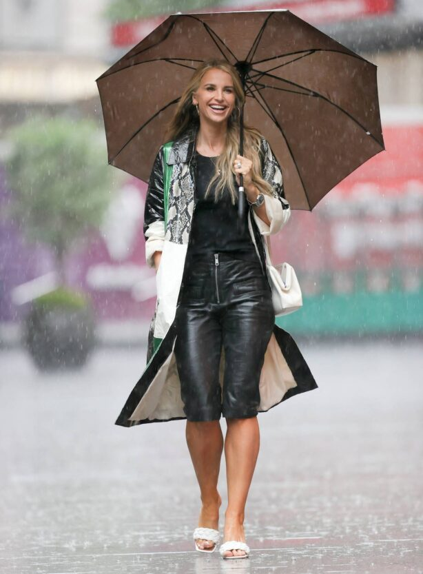 Vogue Williams - In leather short pants on the rain at Heart radio studio in London