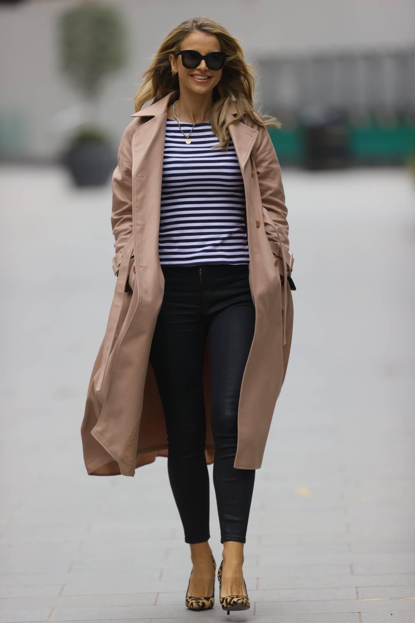 Vogue Williams - In leggings and animal print heals in London
