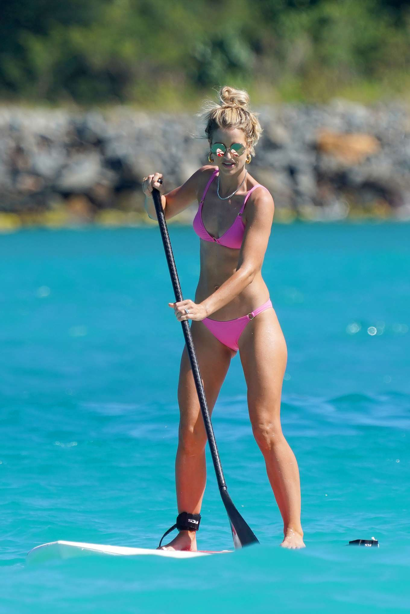 Vogue Williams in Pink Bikini Paddleboarding at a beach in St. Barth