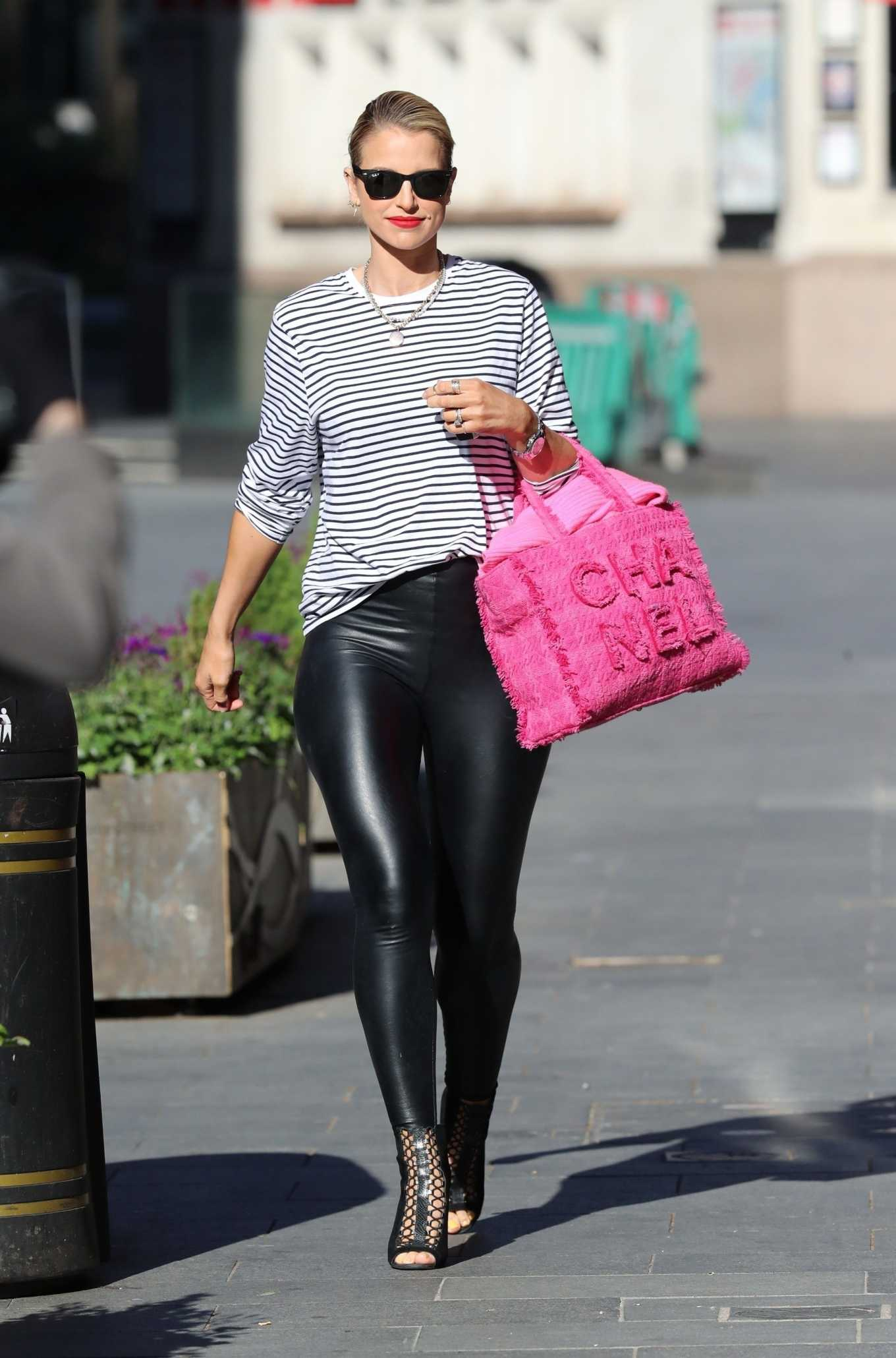 Vogue Williams in PVC Leggings and stripes exits Heart Radio show in London