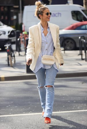 Vogue Williams - Looks in cream jacket and ripped jeans at the Global Offices in London