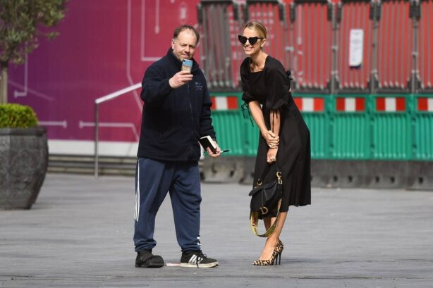 Vogue Williams - Takes a selfie with a fan in London