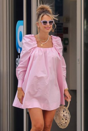 Vogue Williams - Wearing a pink mini dress while leaving Global Radio Studios in London