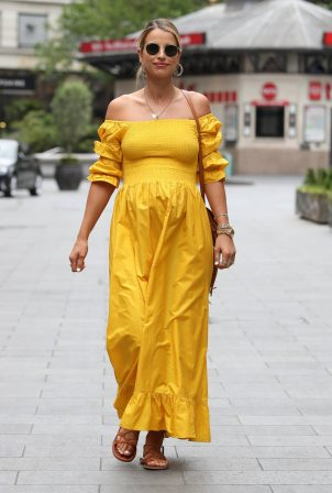Vogue Williams - Wearing a yellow dress while arriving at Global Radio in London