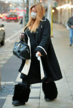 Wendy Williams - In a Chanel coat, alligator Birkin bag and ski bunny boots in New York