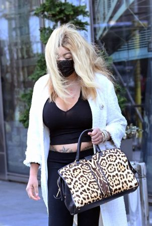 Wendy Williams - Shows her tattoos while out in New York