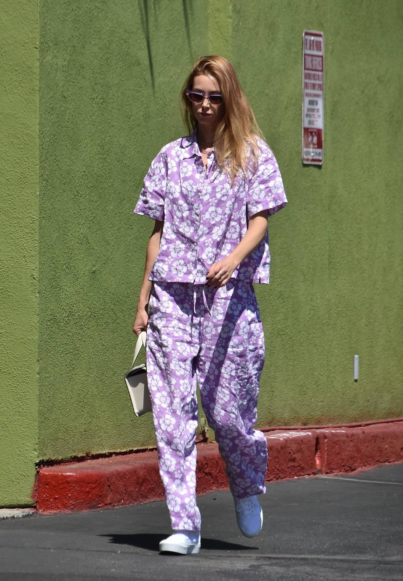 Whitney Port - wearing a lavender floral print outfit and matching sunglasses