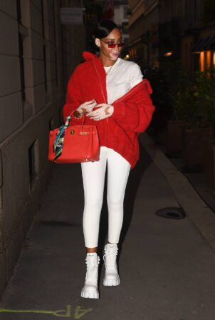 Winnie Harlow - Donning a red jacket while out during Milan Fashion Week