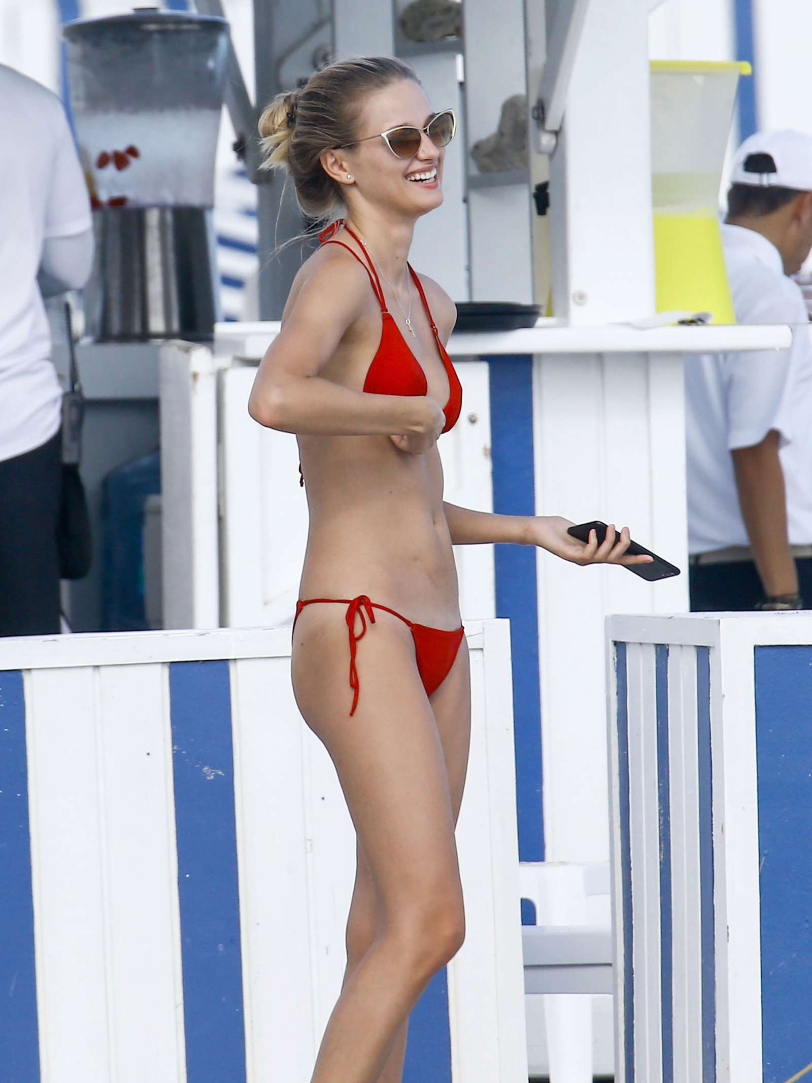 Xenia Micsanschi in Red Bikini on the beach in Miami
