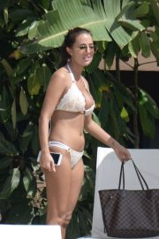 Yazmin Oukhellou in a lacy white and cream bikini in Marbella