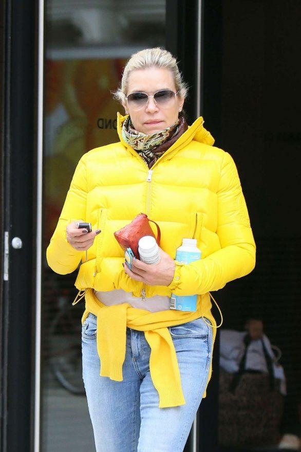 Yolanda Hadid in Yellow Puffer Jacket - Leaves Gigi's apartment in NYC