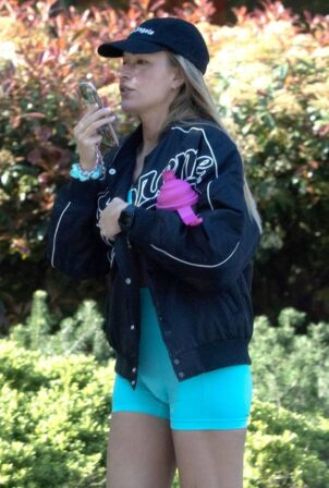 Zara McDermott - Wearing a blue lycra bodysuit and Converse Trainers while out in London