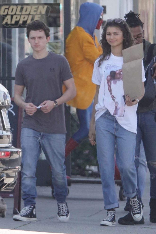 Zendaya and Tom Holland - Pose with a Spiderman statue at a comic store in LA