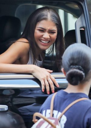 Zendaya greets some of her fans from her car in New York