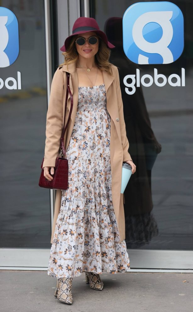 Zoe Hardman - In summer dress a print boots and burgundy hat in London
