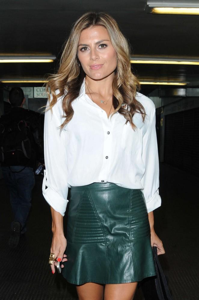 Zoe Hardman in Green Mini Skirt out in London