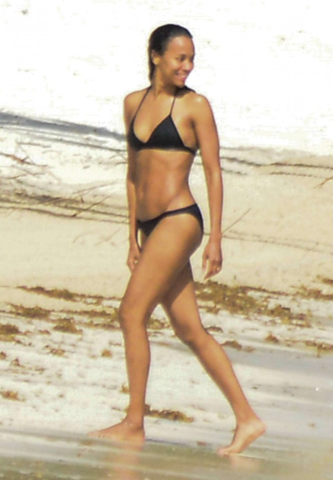 Zoe Saldana in Black Bikini on vacation in Mexico