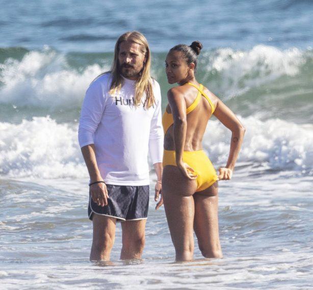 Zoe Saldana - In a yellow swimsuit in Malibu