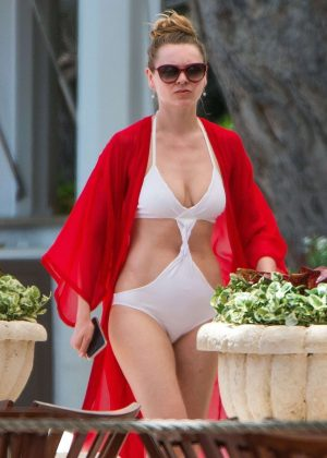 Zoe Salmon in White Swimsuit on the Beach in Barbados