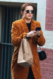 Zoey Deutch in a bathrobe style jacket shopping in Manhattan