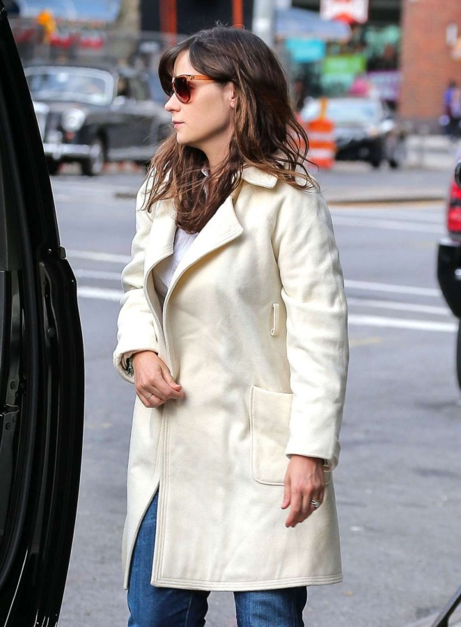 Zooey Deschanel in White Coat Out in LA