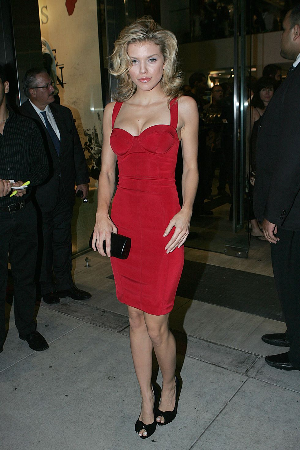 annalynne-mccord-cleavagy-in-red-dress-at-party-on-rodeo-drive-01