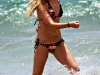 ashley-tisdale-in-bikini-on-the-beach-in-maui-09