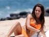 ashley-tisdale-orange-bikini-candis-at-the-beach-in-hawaii-10