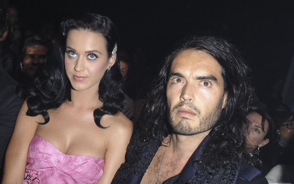 katy-perry-shows-cleavage-at-john-galliano-fashion-show-09