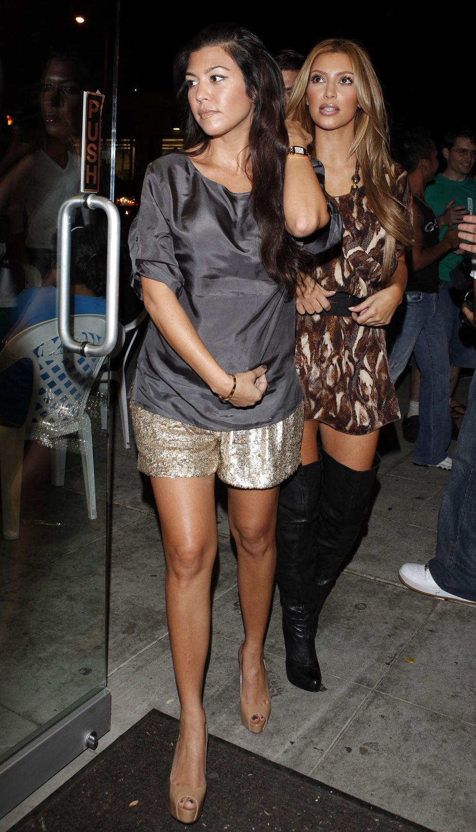 kim-and-kourtney-kardashian-at-millions-of-milkshakes-in-los-angeles-07