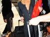 lindsay-lohan-cleavage-candids-at-lax-airport-02