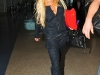 lindsay-lohan-cleavage-candids-at-lax-airport-07