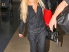lindsay-lohan-cleavage-candids-at-lax-airport-09