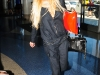 lindsay-lohan-cleavage-candids-at-lax-airport-11