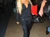 lindsay-lohan-cleavage-candids-at-lax-airport-12