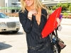 lindsay-lohan-cleavage-candids-at-lax-airport-15