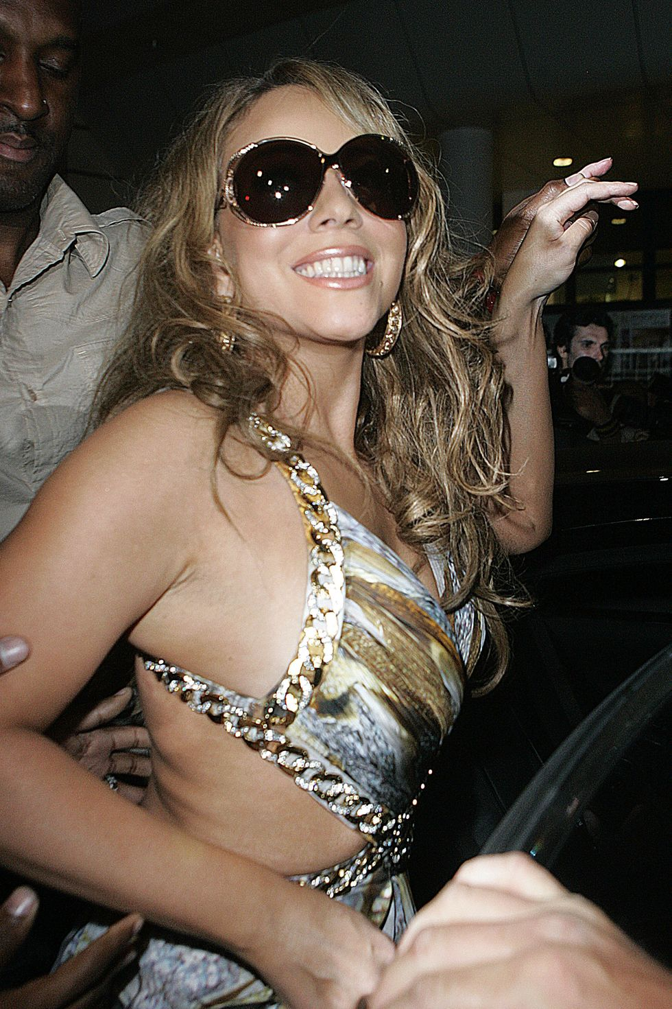 mariah-carey-at-party-on-robert-cavallis-yacht-in-cannes-01